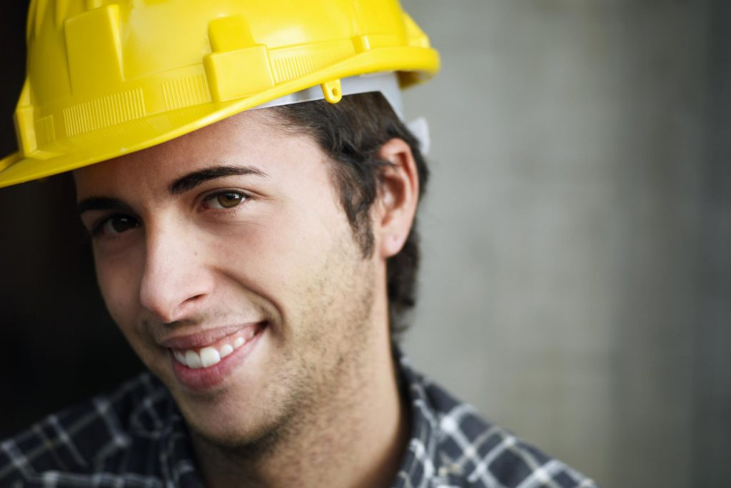 construction worker smiling during work